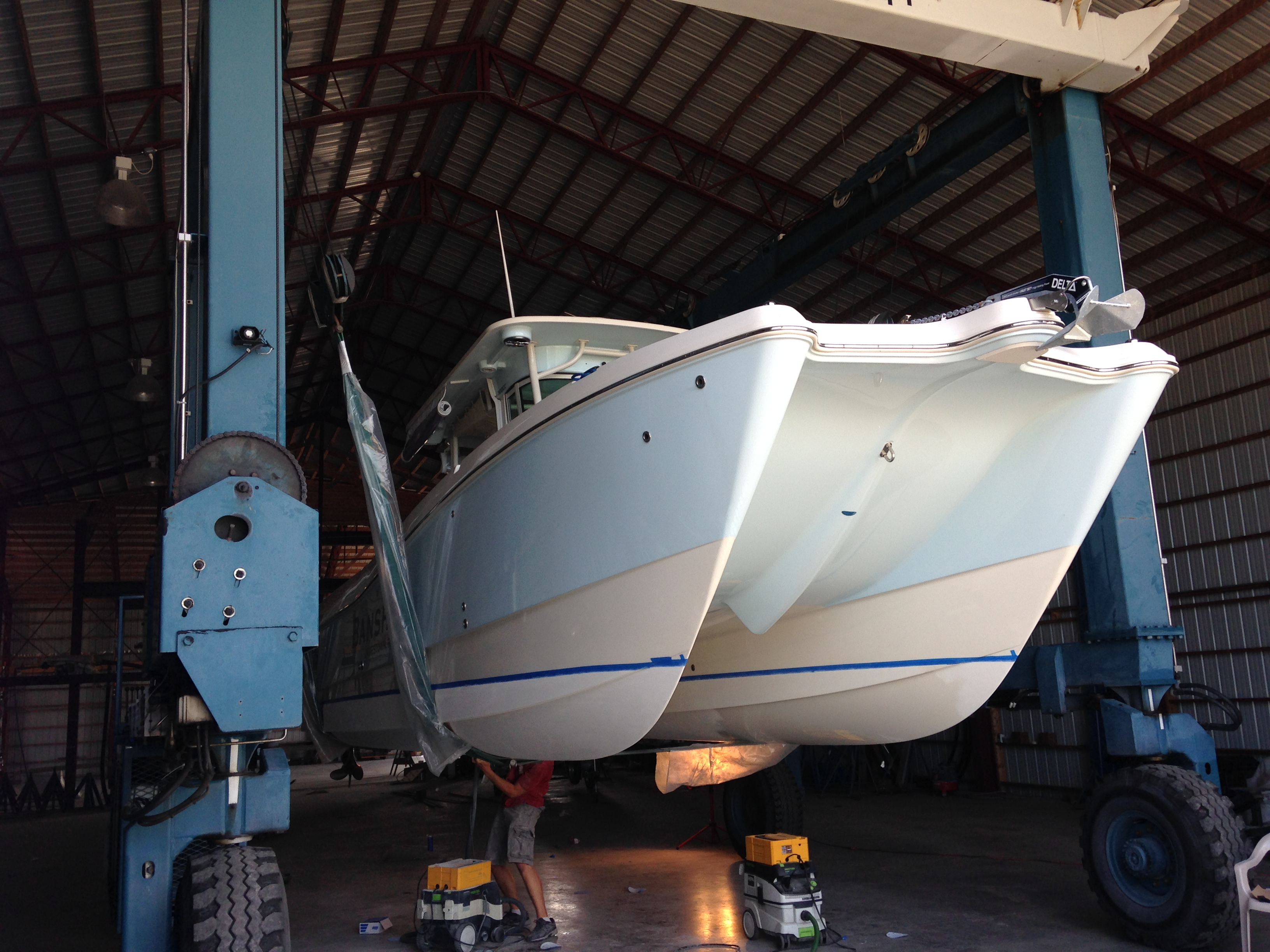 Prepping a new Worldcat powerboat for barrier coat and bottom paint